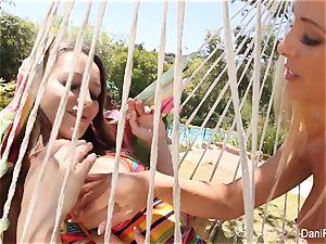Dani and Cherie plumb on the hammock