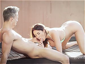 buxomy wonder stunner Anissa rides a fuck-stick by the pool