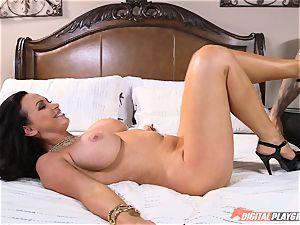 ultra-kinky honey Nikki Benz gets a phat cumload on her bra-stuffers