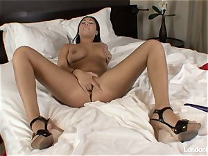 Pierced chinese London Keyes plays with her vulva in couch