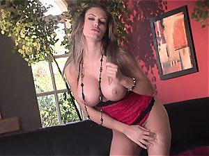 Jenna Presley takes it off leisurely to display off her enormous jugs and smoking assets